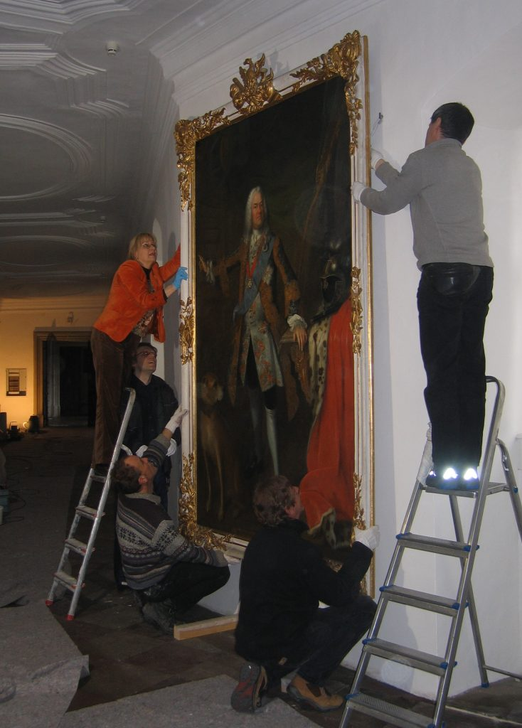 Installation of a baroque painting after its conservation and restoration treatment - maintenance and repair.