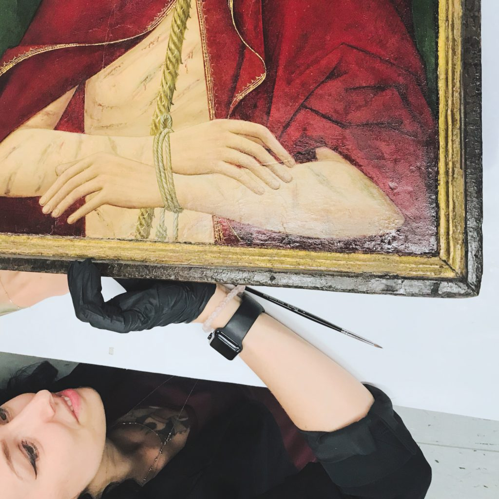 Founder and Fine Art Conservator Kamila M. Korbela during the treatment of a medieval panel painting.
